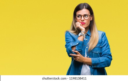 Young beautiful woman over wearing glasses over isolated background thinking looking tired and bored with depression problems with crossed arms.
