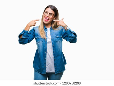 596c65c347248 Young beautiful woman over wearing glasses over isolated background smiling  confident showing and pointing with fingers