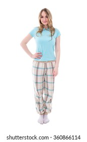 young beautiful woman in pajamas isolated on white background