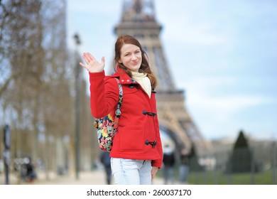 Young beautiful woman in Paris posing near the Eiffel tower