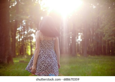 Young beautiful woman in park. Nature