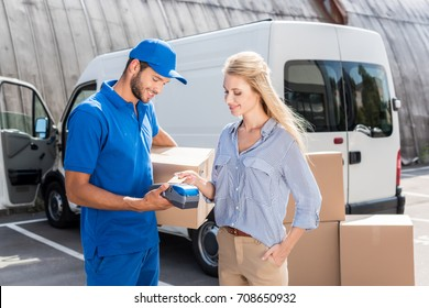 young beautiful woman paying for delivery with card