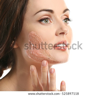 Young beautiful woman with peeling scrub on face isolated on white