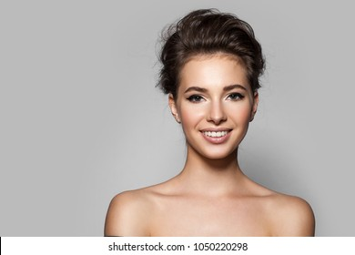 Young beautiful woman with perfect skin with black arrows on the eyes and white teeth. Smiling at the camera
