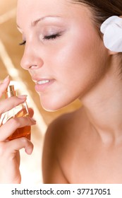 young beautiful woman with perfume