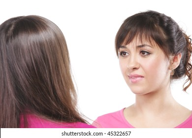 Young beautiful woman in pink listens counterpart with attention