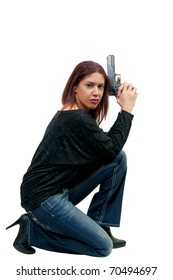 A young and beautiful woman police detective holding a handgun