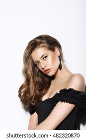 Young beautiful woman portrait. Black dress, a stylish makeover.