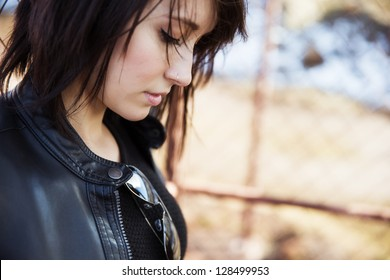 Young beautiful woman portrait, rocker wearing.