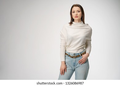 young beautiful woman posing in jeans on white background
