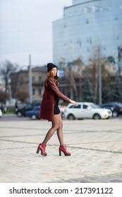 young beautiful woman posing outdoors. stylish fashion portrait