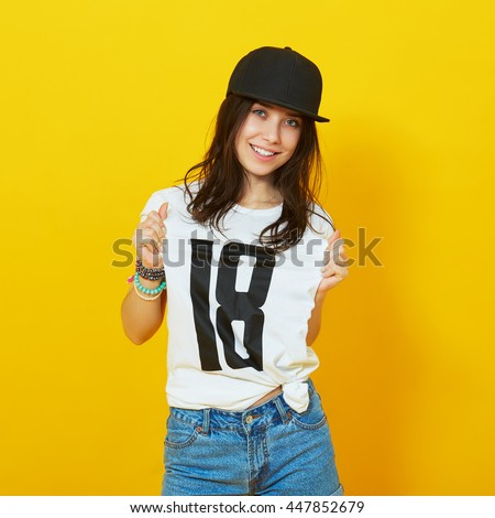 688c7fd4d40 Young beautiful woman posing with white t-shirts with 18 text on it. Girl