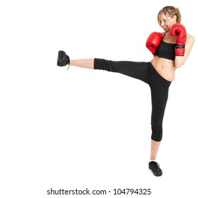 Young beautiful woman practicing martial arts isolated on white, full length