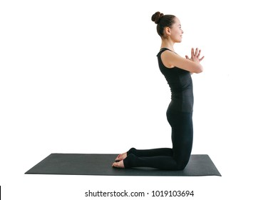 Young beautiful woman practicing yoga and gymnastic isolated on white background. Wellness concept. Classes in single sports.