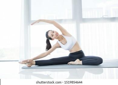 Young beautiful woman practicing yoga