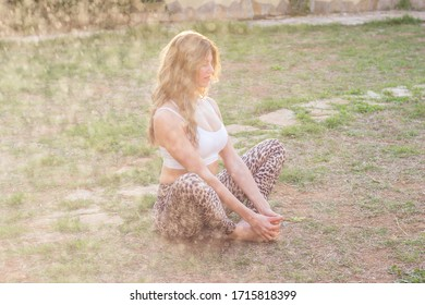 Young beautiful woman practicing yoga meditation