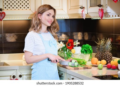 A young beautiful woman is preparing a salad of various vegetables in the kitchen. The concept of a healthy diet and lifestyle