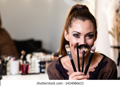 Young beautiful woman and professional beauty make up artist vlogger or blogger recording makeup tutorial to share on website or social media