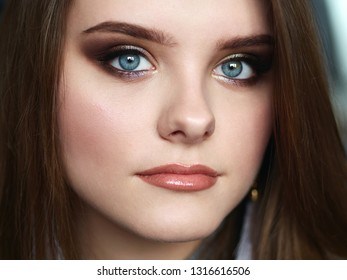 Young beautiful woman with professional make up and hairstyle with