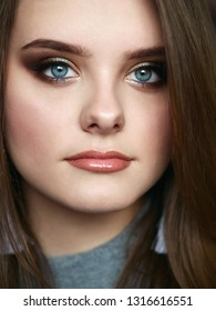 Young beautiful woman with professional make up and hairstyle