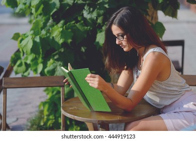 young beautiful woman read a book
