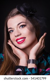 young beautiful woman with red lips and makeup