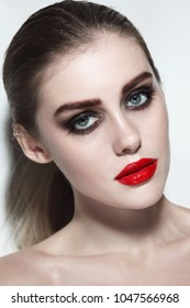 Young beautiful woman with red lipstick and smoky eye make-up