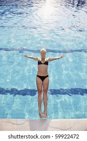 young beautiful woman relax and have fun with splashing water at hotel swimming pool young beautiful woman relax and have fun with splashing water at hotel swimming pool
