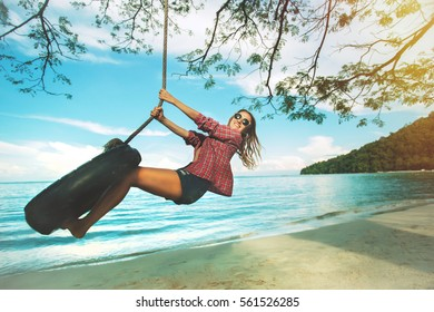 Young beautiful  woman relax on the beach, tropical swing, sand, sunset.