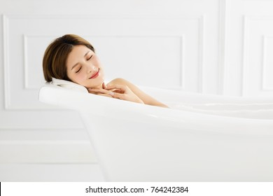 young Beautiful woman relaxing in bathtub