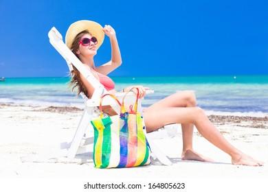Young beautiful woman relaxing at beach