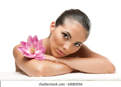 Young beautiful woman relaxing with lotus flower at spa isolated on white background, professional beauty makeup
