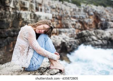 Young beautiful woman relaxing near the sea