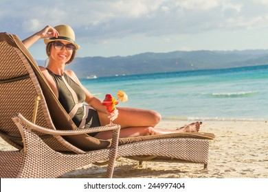 young beautiful woman relaxing on tropical beach, summer vacations
