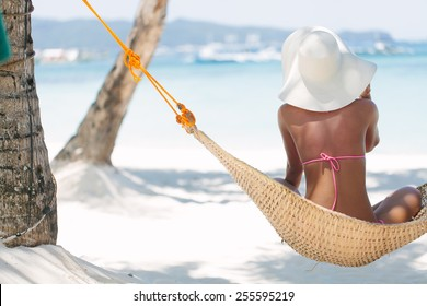 Young beautiful woman relaxing on the hammock