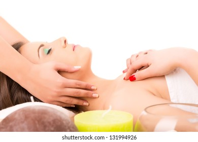 A young beautiful woman relaxing at a spa (wellness concept)