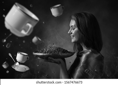 Young beautiful woman with roasted coffee beans. Flying coffee cups, saucers and spoons. Conceptual image on the theme of coffee. Black and white.