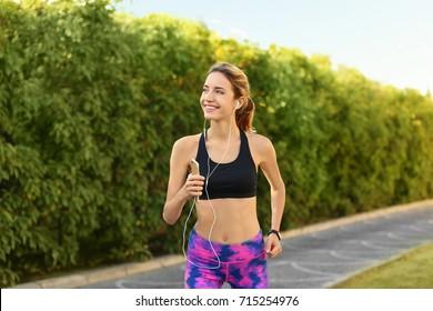 Young beautiful woman running outdoors