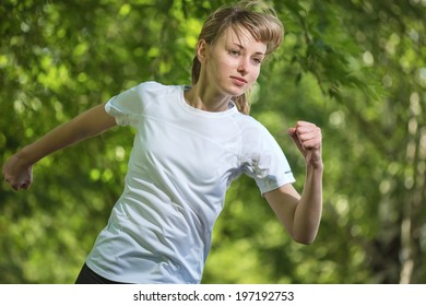 The young beautiful woman runs on park