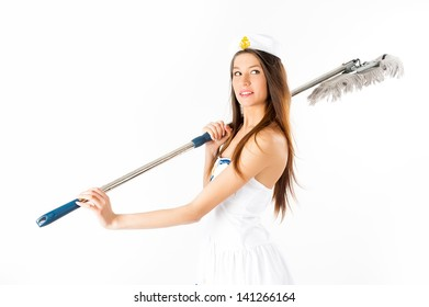 Young beautiful woman in sailor suit with mop at white background