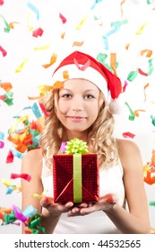 Young beautiful woman with santa hat and gift box