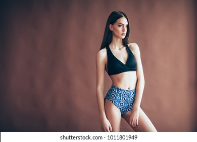 Young beautiful woman in sexy sportswear posing in studio. Sports style, fitness, shaping, aerobics concept