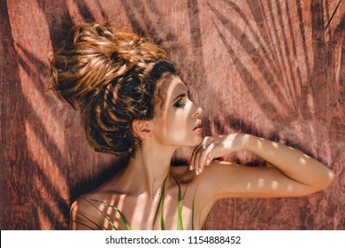 young beautiful woman with shadows on face with eyes closed