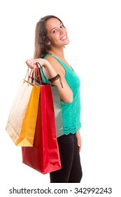 Young beautiful woman with shopping bags, isolated over copy space background