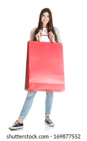 Young beautiful woman is shopping. Isolated on white.