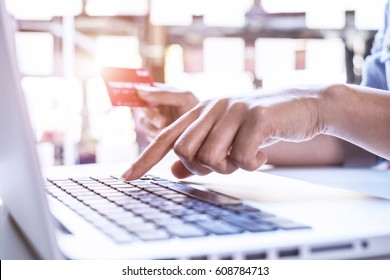 Young beautiful woman shopping online using laptop and credit card at office