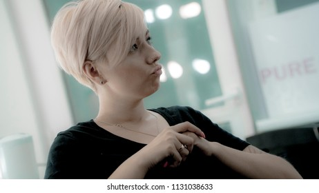 Young beautiful woman with short haircut and black t-shirt