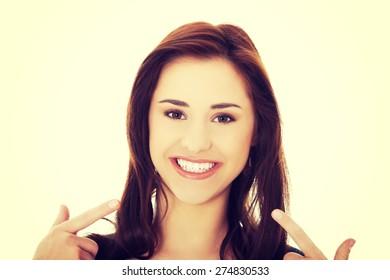 Young beautiful woman showing her teeth