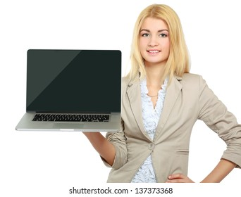 Young beautiful woman showing a laptop, isolated on white background