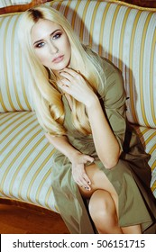 Young beautiful woman siting on the sofa
